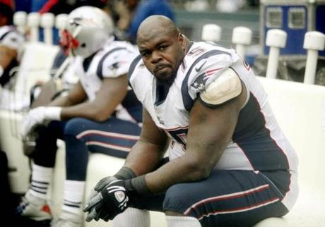 A sullen Patriots defensive lineman Vince Wilfork sat on the bench near the end of Sunday's loss.